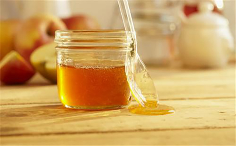 吃蜂蜜有护肝解酒的好处图片